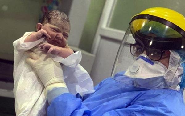 امرأة مصابة بكورونا تنجب طفلاً بـ